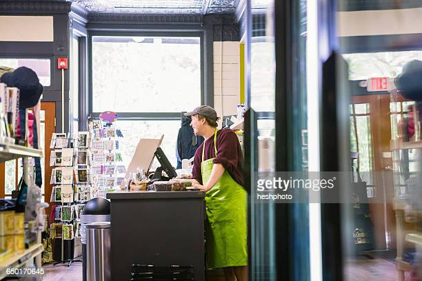 clerk in general store, hague, usa - heshphoto stock pictures, royalty-free photos & images