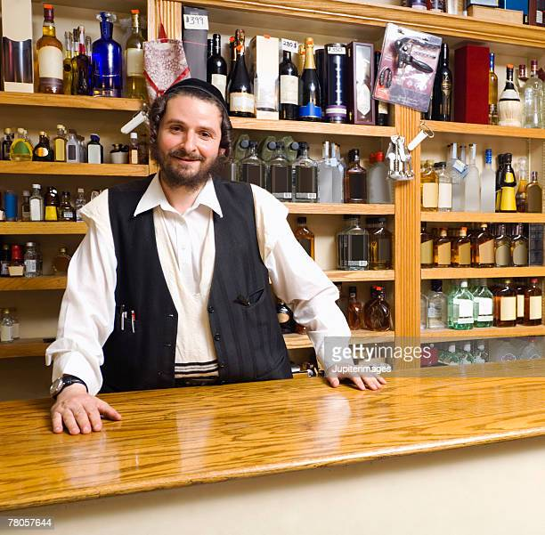clerk in liquor store - jewish man stock photos and pictures