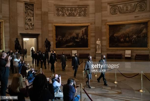Clerk of the House Cheryl Johnson along with House Sergeant-at-Arms Tim Blodgett lead the Democratic House impeachment managers as they walk in the...