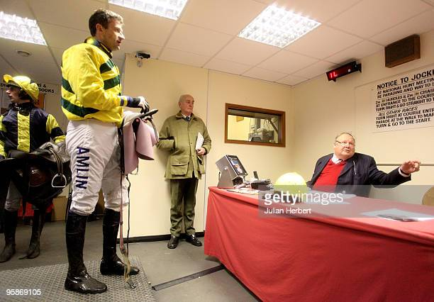 Clerk of The Scales Peter Sayer wieghs jockey Andrew Thornton in at Folkestone Racecourse on January 19 2010 in Folkestone England Today was his last...
