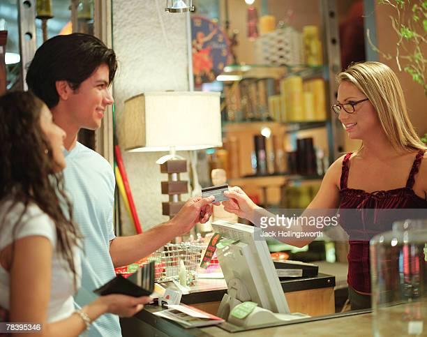 Clerk ringing up customers