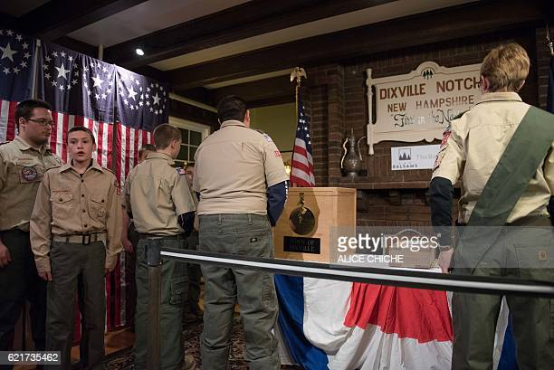 A clerk tabulates ballots at a polling station just after midnight on November 8 2016 in Dixville Notch New Hampshire the first voting to take place...