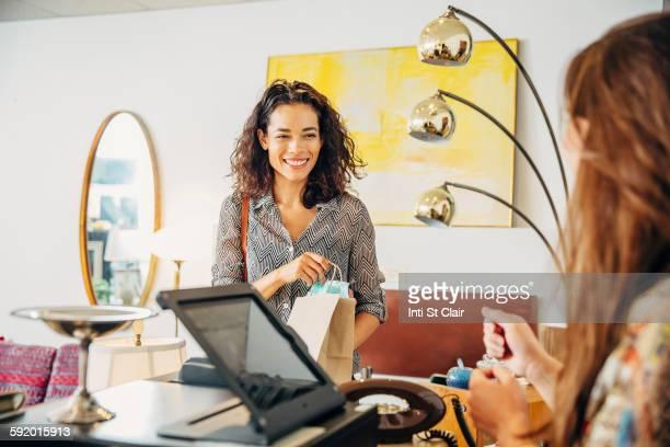 Clerk talking to customer shopping in store
