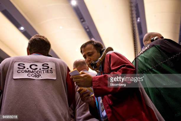 A clerk talks on a phone as he works in the crude oil and natural gas options pit on the floor of the New York Mercantile Exchange in New York US on...