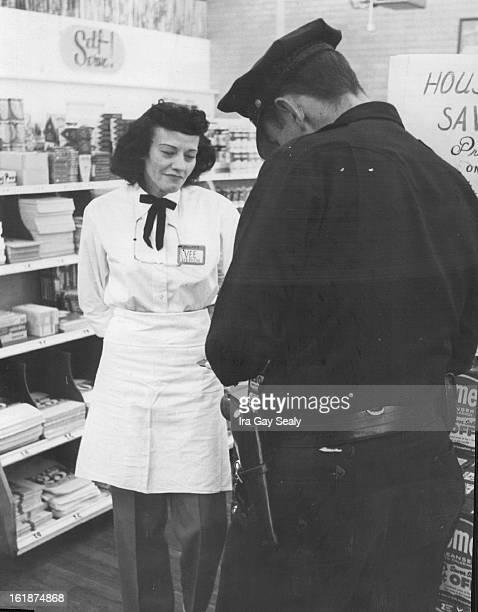 OCT 3 1958 Clerk Tells Of Stickup Mrs Velma Stevens clerk who was held up by gunman at a Miller's Super Market cash register Friday morning relates...
