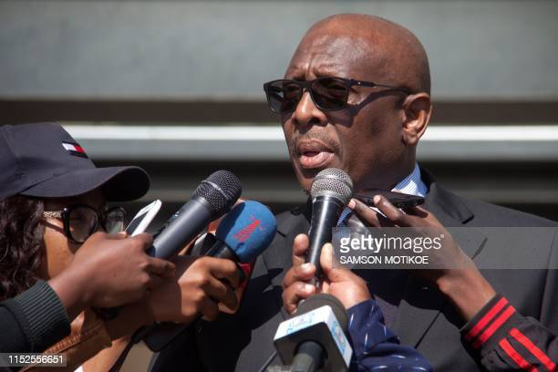 Clerk to the National Assembly Fine Maema addresses the crowd on a farmers' letter during a protest against regulations forcing farmers to sell their...