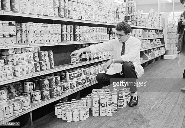 Clerk Tom Wainwright removes cans of cranberry from the shelves in an H C Bohack supermarket in Jackson Heights Queens Nov 10th The Bohack Co which...