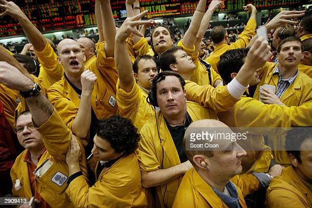Clerks and traders relay offers in the Eurodollar futures pit at the Chicago Mercantile Exchange January 28, 2004 in Chicago Illinois. The Federal...