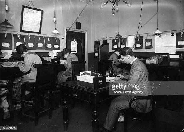 Clerks at work in the offices of a London bus company