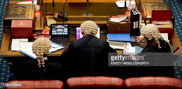 Clerks listen to the debate on the European Withdrawal Agreement Bill in the House of Lords in London on January 21 2020 Britain's House of Lords is...