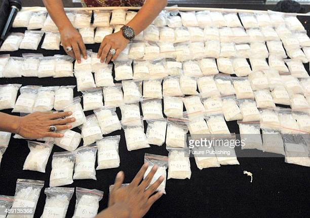 Clerks present methamphetamine seized in a raid by the National Polices Narcotics Directorate at the police headquarters on September 18 2015 in...