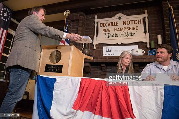 Clerks tabulate ballots at a polling station just after midnight on November 8 2016 in Dixville Notch New Hampshire the first voting to take place in...