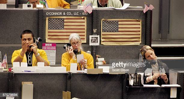 Clerks take orders above the cattle futures and options pits at the Chicago Mercantile Exchange March 14 2006 in Chicago Illinois The pits saw a...