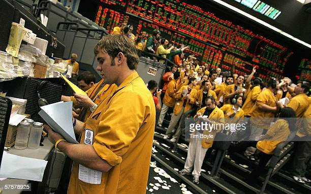 Clerks work in the Eurodollar Futures Pit at the Chicago Mercantile Exchange shortly after an interest rate increase was announced May 10 2006 in...