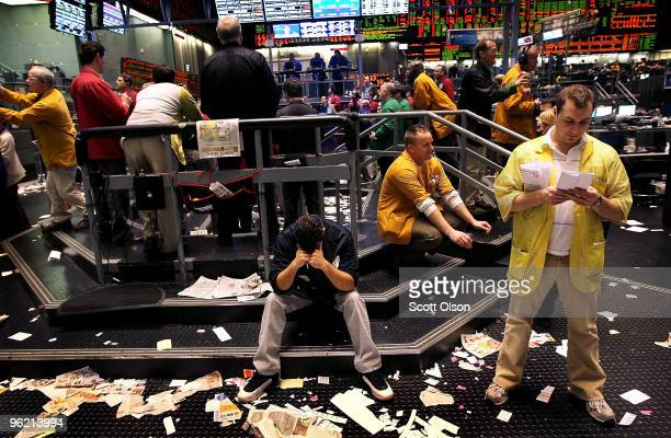 Clerks work in the Eurodollar pit at the CME Group following news from the Federal Open Market Committee meeting concerning short-term interest rates...