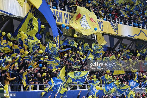Clermont Auvergne fans celebrate during the Heineken Cup quarter final match between Clermont Auvergne and Montpellier at Stade Marcel Michelin on...