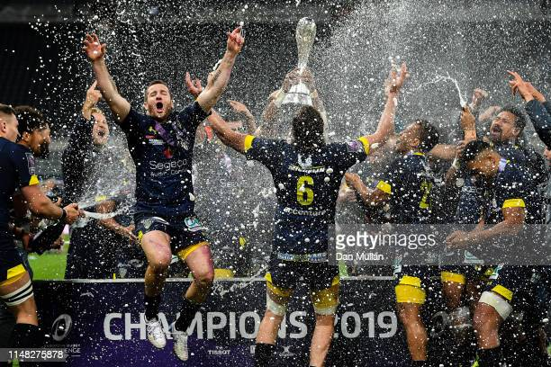 Clermont Auvergne players celebrate spraying champagne after winning the Challenge Cup Final match between La Rochelle and ASM Clermont at St James...