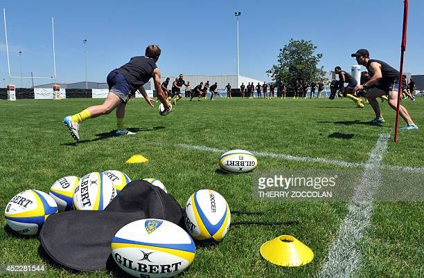 ASM Clermont Auvergne's players take part in a training session at the Stade Des Gravanches stadium in ClermontFerrand central France on July 17 2014...