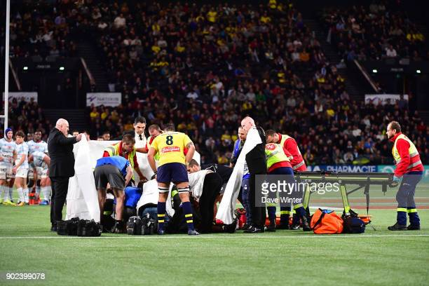 Clermont captain Damien Chouly looks on as Samuel Ezeala of Clermont receives treatment after being knocked unconcious during the Top 14 match...