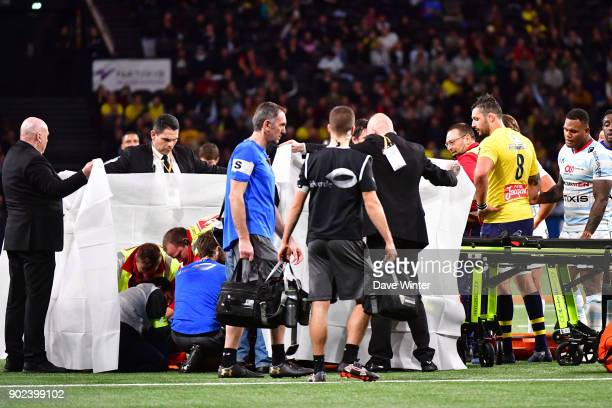 Clermont captain Damien Chouly looks on as Samuel Ezeala of Clermont receives treatment after being knocked unconcious tackling Virimi Vakatawa of...