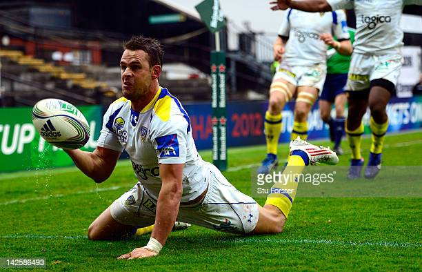 Clermont fullback Lee Byrne dives over to score during the Heineken Cup Quarter Final between Saracens and ASM Clermont Auvergne at Vicarage Road on...