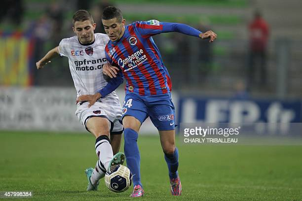 Clermont midfielder Yohan Betsch fights for the ball with Caen forward Florian Raspentino on October 28 2014 during a French League Cup football...