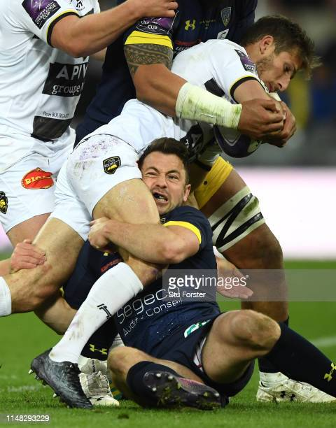 Clermont player Greig Laidlaw tackles La Rochelle fullback Vincent Rattez during the Challenge Cup Final match between La Rochelle and ASM Clermont...