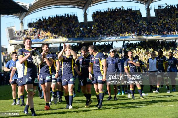 Clermont players celebrate their team's victory on the pitch after the European Rugby Champions Cup semifinal match between ASM Clermont and Leinster...