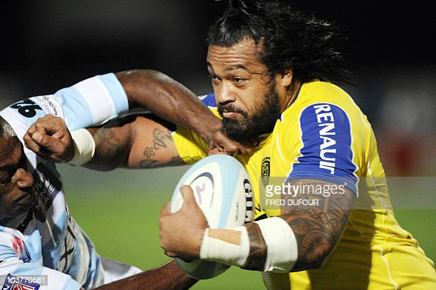 Clermont Sione Lauaki vies with Racing Metro's Serely Bobo during during the French Top 14 rugby union match Racing Metro vs Clermont at the Yves du...