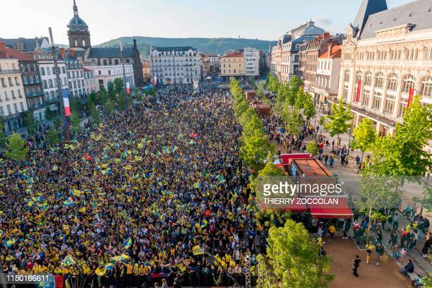 Clermont supporters wave flags on the Place de Jaude square in Clermont-Ferrand, central France, as they watch on a giant screen the French Top 14...