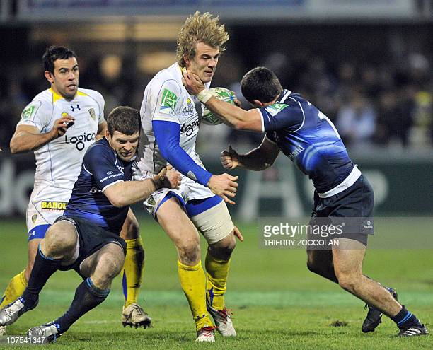 ClermontFerrand's center Aurelien Rougerie tries to escape the tackle of two players from Leinster during the European Cup HC match ASM Clermont...