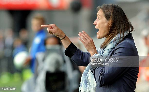 ClermontFerrand's French coach Corinne Diacre reacts during the French L2 football match between Brest and ClermontFerrand on August 4 2014 at the...