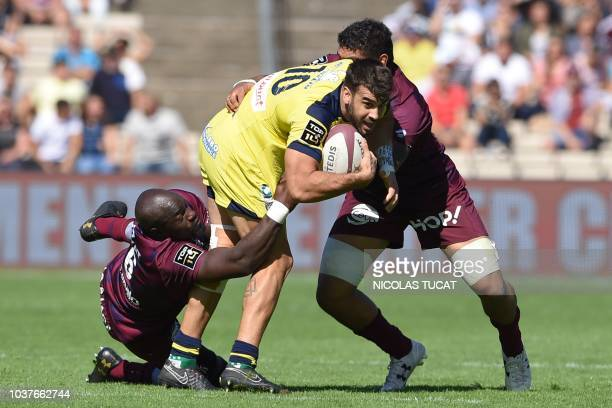 Clermont's Argentinian flyhalf Patricio Fernandez is tackled during the French Top 14 rugby union match between BordeauxBegles and Clermont during...