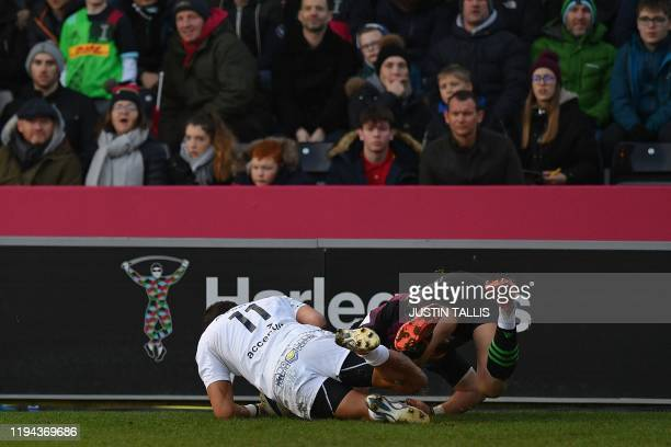 Clermont's Australian centre Peter Betham scores his team's first try during the European Rugby Champions Cup first round pool 3 rugby union match...