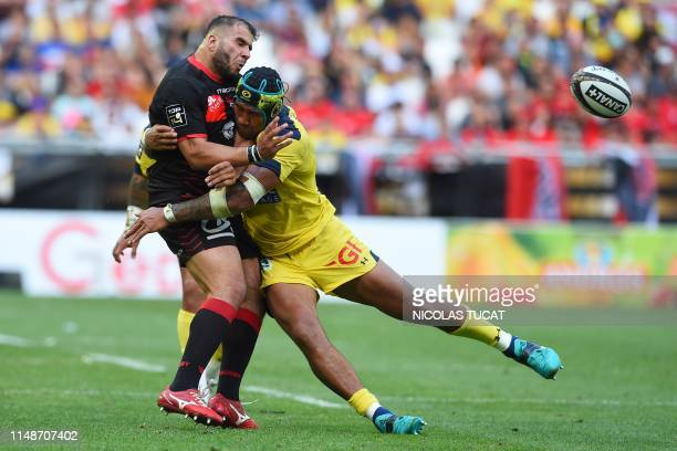 TOPSHOT Clermont's Australlian lock Sebastien Vahaamahina collapses with Lyon's prop Hamza Kaabeche during the French Top 14 semifinal rugby union...