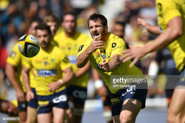 Clermont's Camille Lopez passes the ball during the French Top 14 rugby union match between La Rochelle and Clermont on September 9 2017 at the...