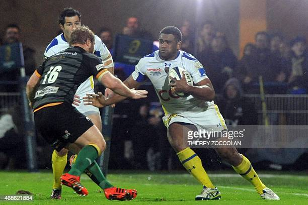 Clermont's Fidji winger Napolioni Nalaga runs with the ballduring the European Rugby Champions Cup 1/4 final match between Clermont and Northampton...