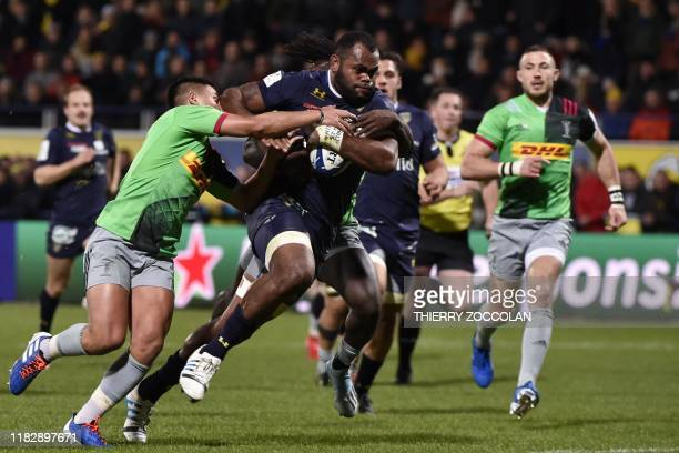 Clermont's Fidjian flanker Peceli Yato runs to score a try during the European Champions Cup rugby union match between Clermont and Harlequins at the...