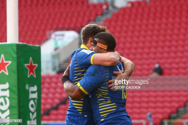 Clermont's Fiji center Apisai Naqalevu is celebrates with teammates after scoring a try during the European Rugby Champions Cup rugby union Group B...