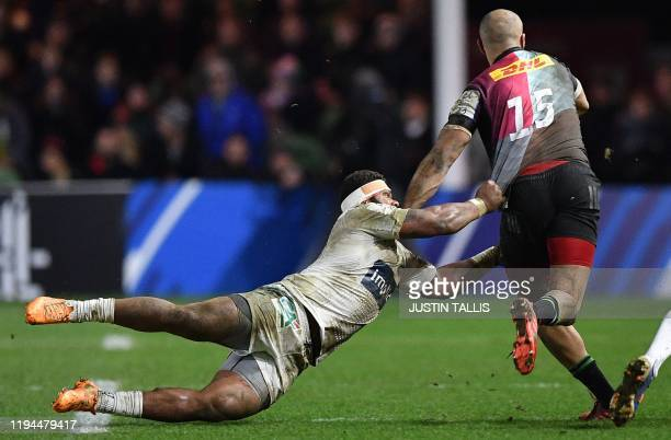 TOPSHOT Clermont's Fijian centre Apisai Naqalevu dives as he tries to tackle Harlequins' English fullback Aaron Morris during the European Rugby...