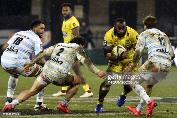 Clermont's Fijian prop Peni Ravai runs with the ball during the French Top 14 rugby union match between ASM Clermont and Racing 92 at the Michelin...