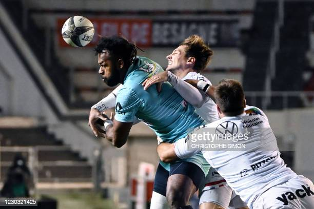 Clermont's Fijian wing Alivereti Raka is tackled by Toulon's French scrum-half Baptiste Serin during the French Top 14 rugby union match between RC...