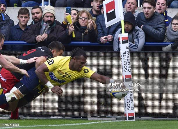 TOPSHOT Clermont's Fijian wing Alivereti Raka scores a try during the French Rugby Union match between Clermont and Lyon at the Michelin stadium in...