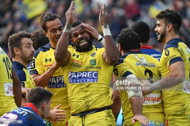 Clermont's Fijian winger Alivereti Raka celebrates with teammates after scoring a try during the French Top 14 rugby union match between Grenoble and...