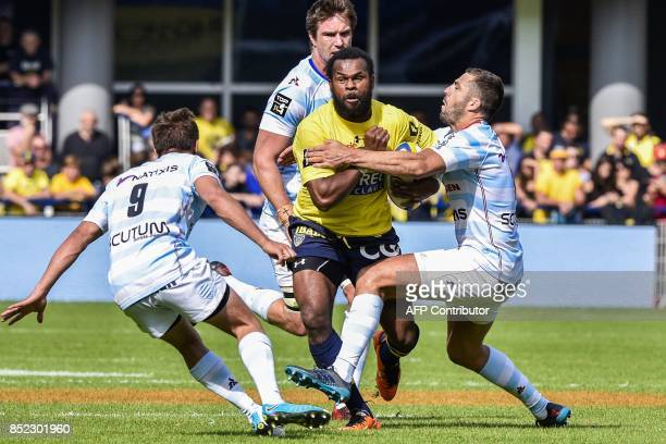 Clermont's Fijian winger Alivereti Raka is tackled during the French Top 14 Rugby Union match ASM Clermont vs Racing 92 at the Michelin stadium in...