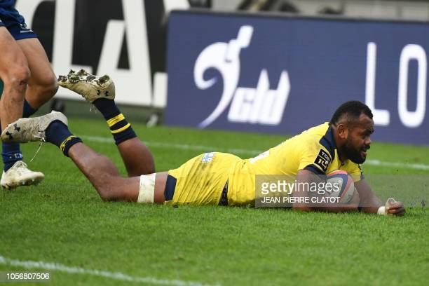 Clermont's Fijian winger Alivereti Raka scores a try during the French Top 14 rugby union match between Grenoble and Clermont on November 3 2018 at...