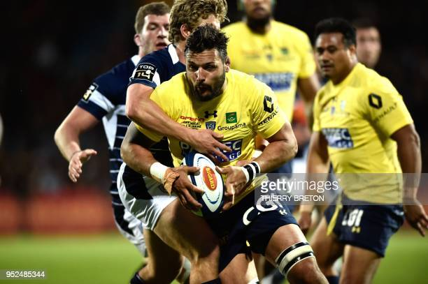 Clermont's flanker Damien Chouly runs with the ball during the French Top 14 rugby union match between SU Agen and ASM Clermont on April 28 2018 at...