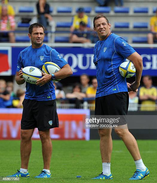 Clermont's French assistant coach Franck Azema and Clermont's NewZealand assistant coach Jono Gibbs look on prior to the French Top 14 rugby union...