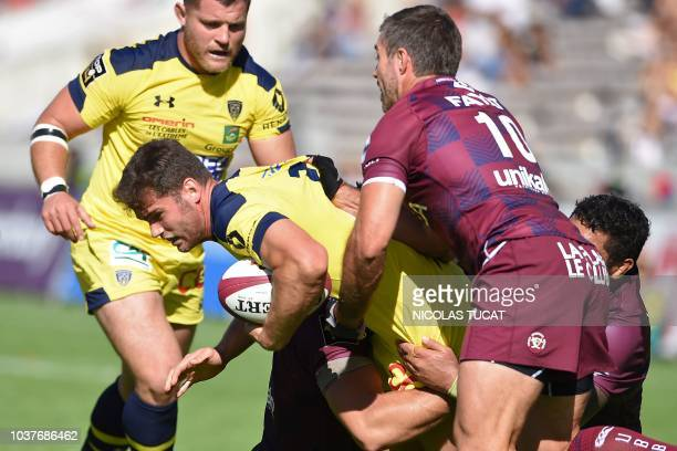Clermont's French centre Damian Penaud is tackled during the French Top 14 rugby union match between BordeauxBegles and Clermont on September 22 2018...