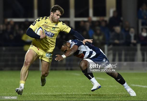 Clermont's French centre Damian Penaud is tackled during the French Top 14 rugby union match between ASM Clermont Aubergne and SU Agen at the...